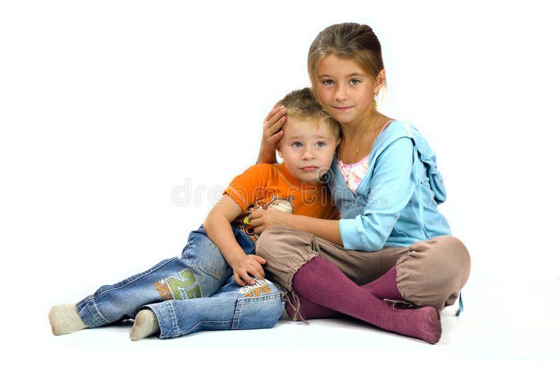 Sister helps her brother royalty free stock photo