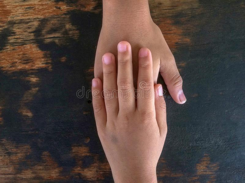Sister, holding hands, encourage brothers. royalty free stock images