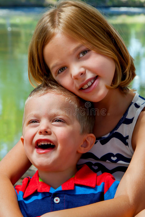 Free Sister Holds Laughing Brother Stock Images - 71389434