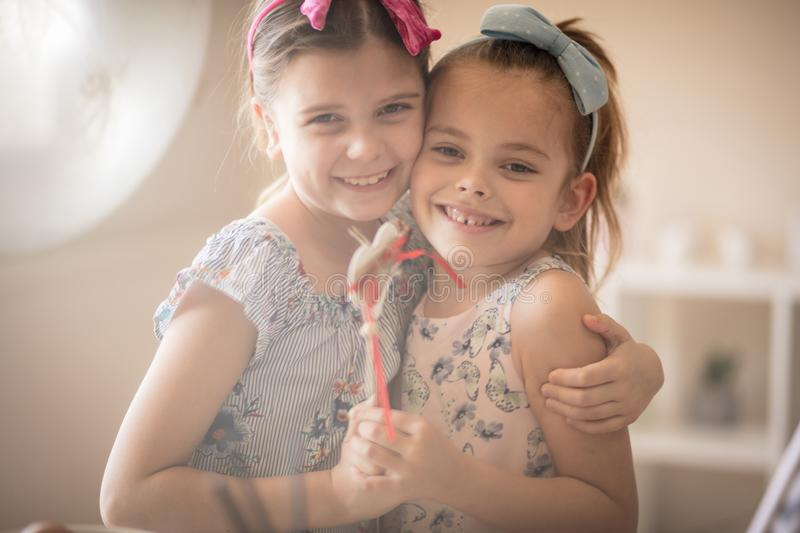 Sister love is the most beautiful thing in the world. Little girls holding heart stock image