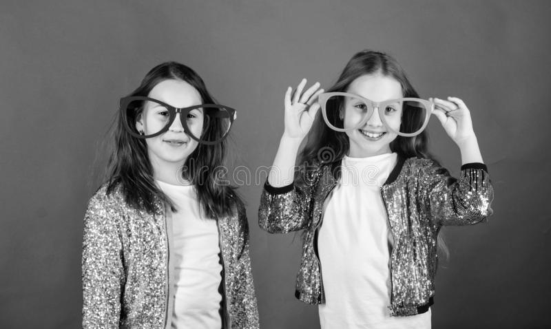 Sisterhood concept. Friendly relations siblings. Sincere cheerful kids share happiness and love. Girls funny big. Sisterhood concept. Friendly relations siblings stock image