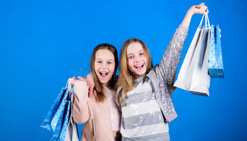 Sisterhood and family. savings on purchases. Sales and discounts. Kid fashion. Small girls with shopping bags. Happy stock photos