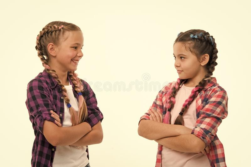 Sisterhood goals. Sisters together isolated white background. Sisterly relationship. Sisterhood is unconditional love. Girls cool confident sisters with folded stock image