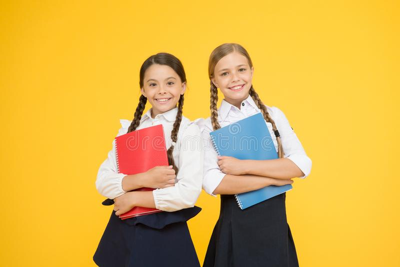 Sisterhood. kids learning grammar. back to school. little girls in school uniform. reading story. childrens literature. Dictionary notebook. Get information stock photography