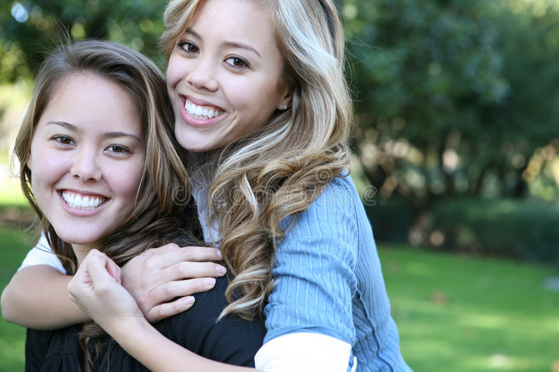 Sisterly Love. Two attractive sisters displaying the love of family royalty free stock images