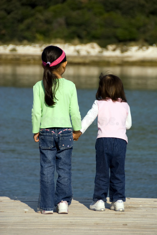 Download Sisters 002 stock image. Image of walk, bond, child, water - 2318115