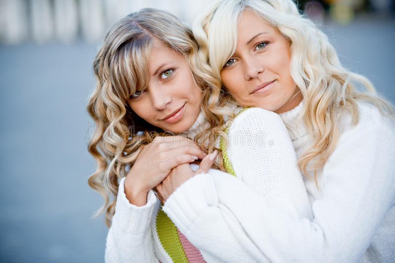 Sisters. Family photo of sisters embracing outdoors closeup royalty free stock photos