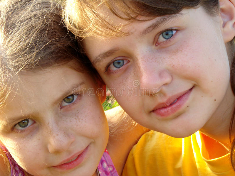 Sisters. Two pretty freckles sisters summer outdoor portrait stock images
