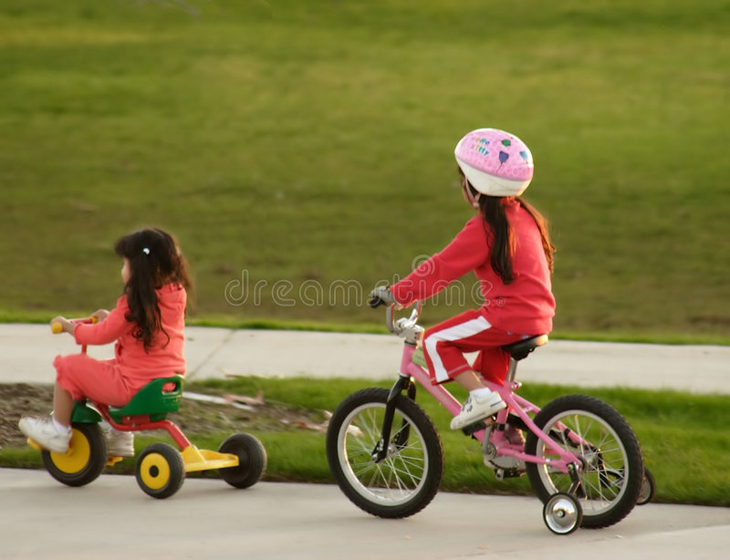 Sisters. Family Sisters Bicycle Riding