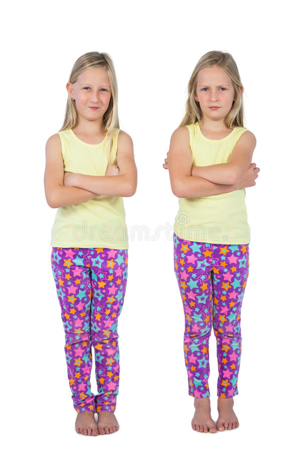 Download Sisters with arms crossed stock image. Image of twin - 32513281