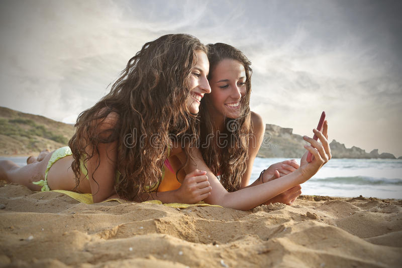 Download Sisters at the beach stock image. Image of sisters, smile - 46743007