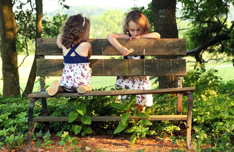 Sisters on Bench royalty free stock photography