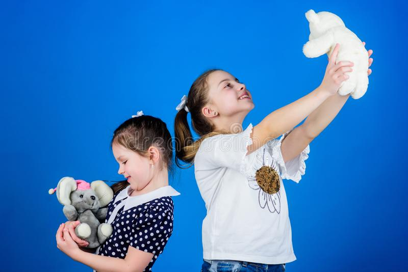 Sisters or best friends play with toys. Sweet childhood. Childhood concept. If you carry your childhood you actually stock image