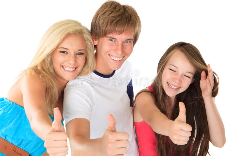 Sisters and brother with thumbs up sign. Smiling happy sisters and brother all with thumbs up sign on white background royalty free stock images