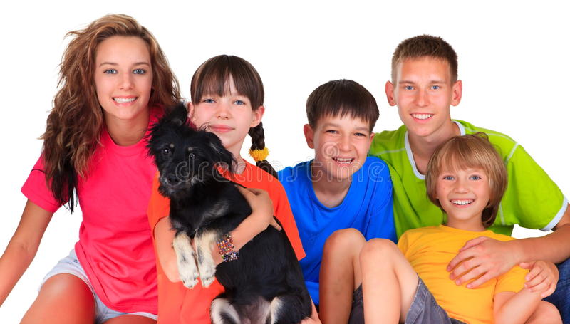 Sisters, brothers and dog pet. Happy colorful family portrait of two sisters, three brothers and the dog pet stock image