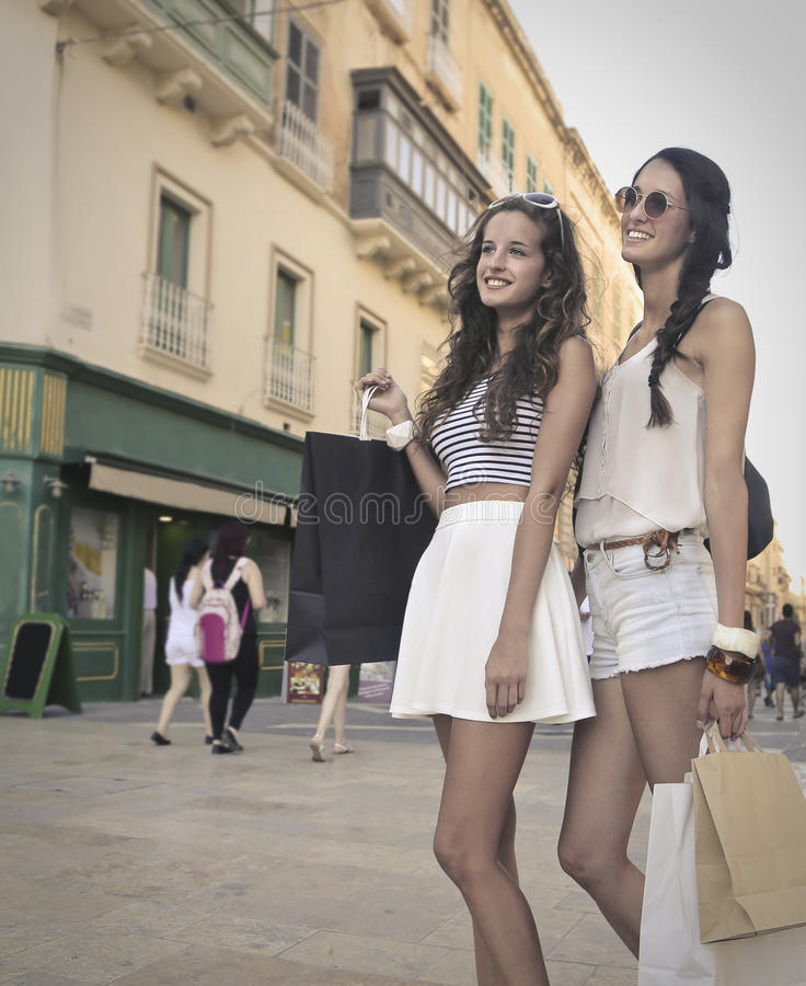 Sisters doing shopping stock photos