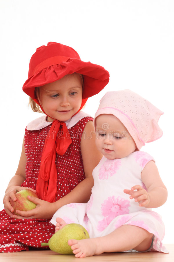 Sisters and fruits royalty free stock photography