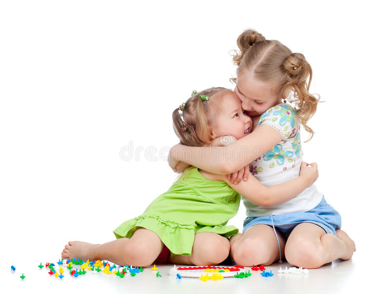 Sisters girls kids playing and embracing royalty free stock photos