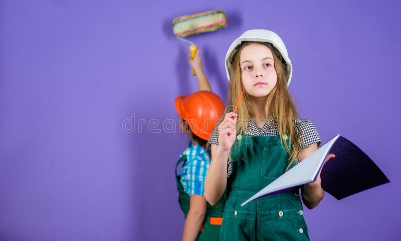 Sisters happy renovating home. Home improvement activity. Kids girls planning renovation. Repaint walls. Move in new. Apartment. Children sisters run renovation stock images