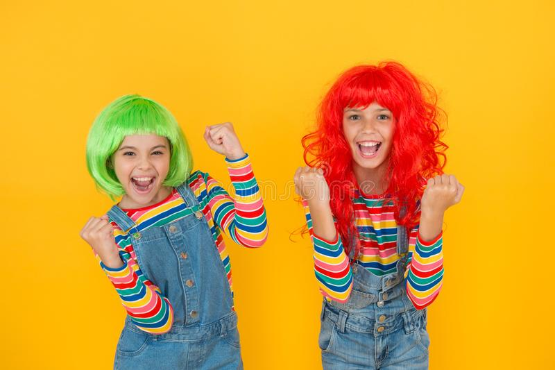 Sisters having fun. Semi permanent color cream. Colored clip in hair extensions. Change color. Kids girls with vibrant stock photos