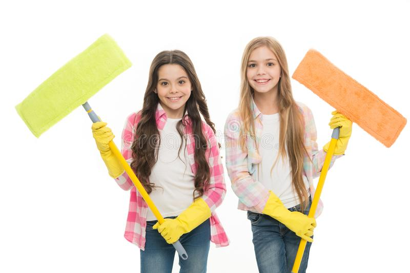Sisters hold wet mops ready start cleaning day. Girls cute kids cleaning around. Keep it clean. Helpful cheerful kids. Cleaning together. Girls with protective stock photography