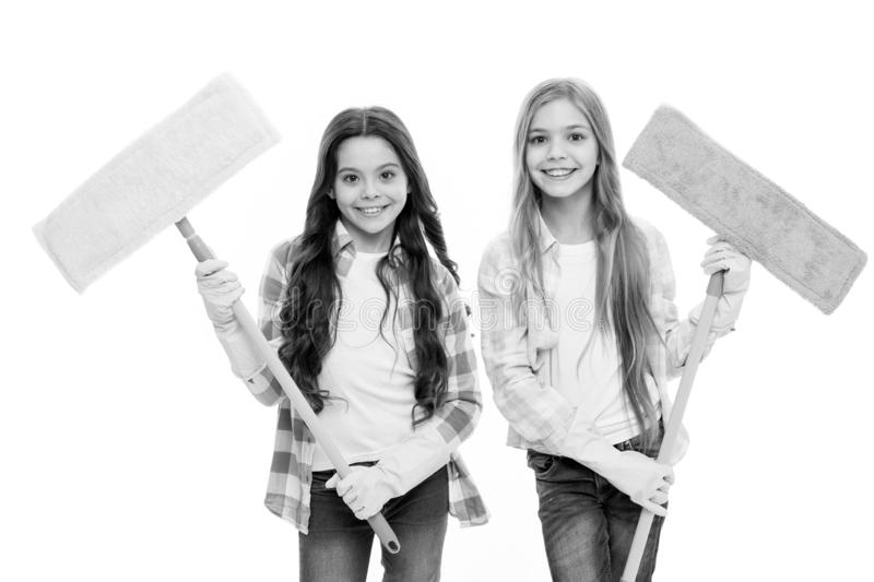 Sisters hold wet mops ready start cleaning day. Girls cute kids cleaning around. Keep it clean. Helpful cheerful kids. Cleaning together. Girls with protective stock image