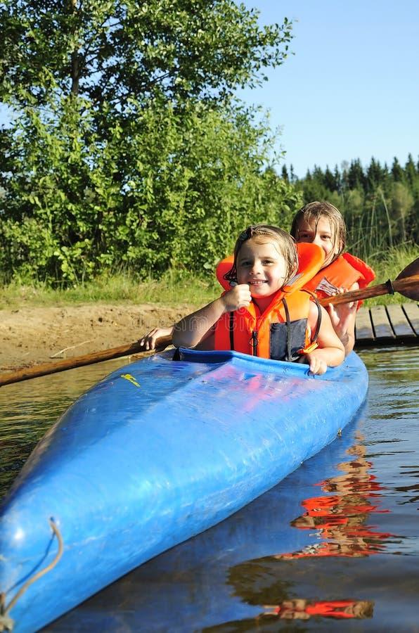 Sisters in kayak stock photos