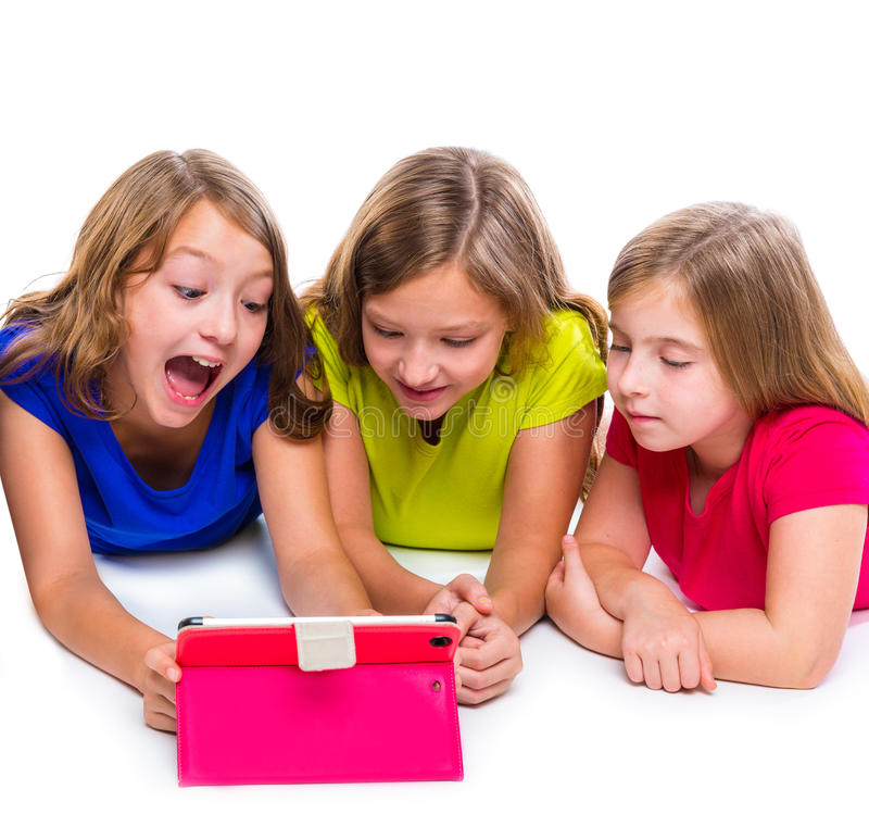 Young Happy Beautiful Family Playing Together On The Beach: Sisters Kid Girls With Tech Tablet Pc Playing Happy Stock