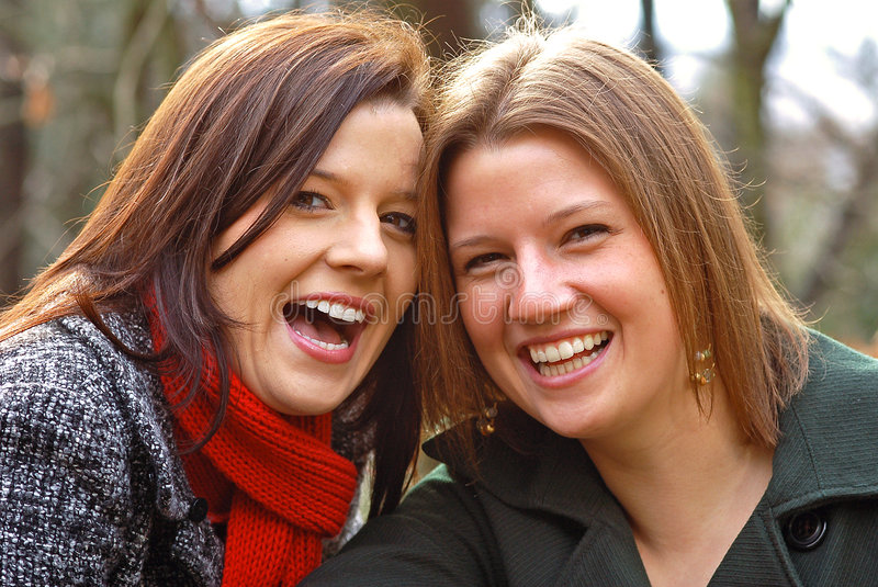 Sisters laughing royalty free stock photography