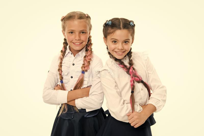 Sisters little girls with braids ready for school. School fashion concept. Be bright. School friendship. Sisterhood. Relationship and soulmates. On same wave royalty free stock photography