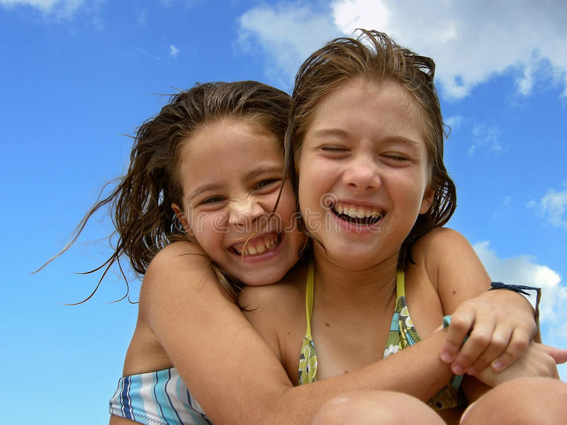 Sisters love 3. Portrait of a two embracing sisters (BFF - best friends forever) laughing on summer vacation in Croatia. Horizontal color photo royalty free stock photos