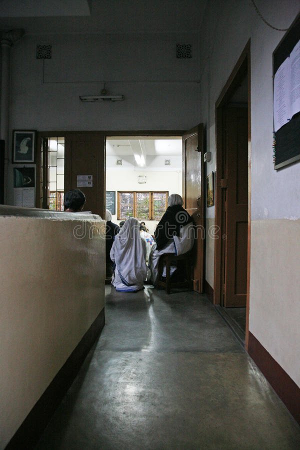 Sisters of The Missionaries of Charity at Mass in the chapel of the Mother House, Kolkata. Sisters of The Missionaries of Charity of Mother Teresa at Mass in the royalty free stock photo