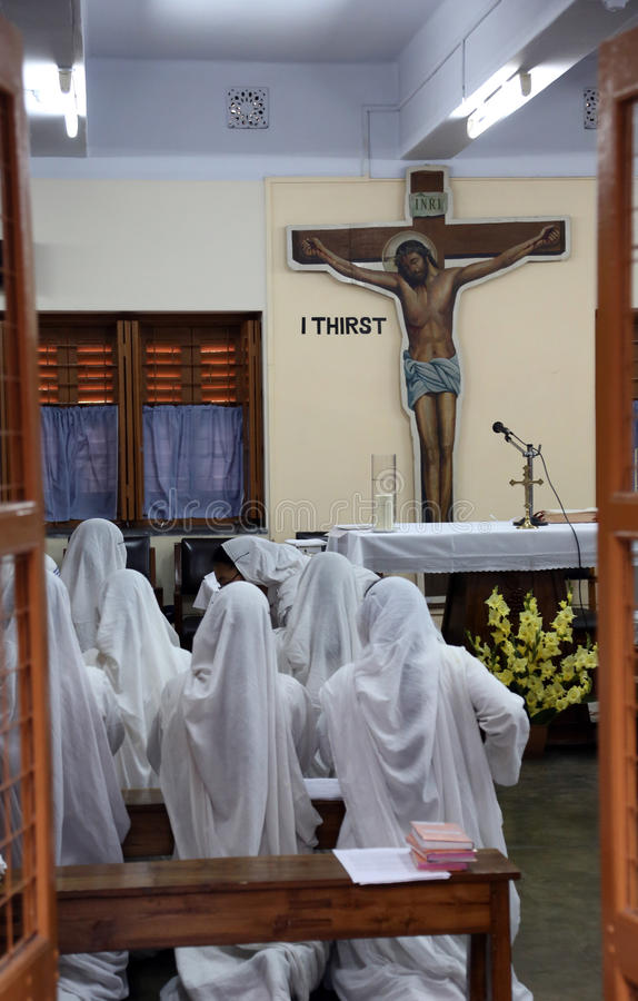 Sisters of The Missionaries of Charity at Mass in the chapel of the Mother House, Kolkata. Sisters of The Missionaries of Charity of Mother Teresa at Mass in the stock images