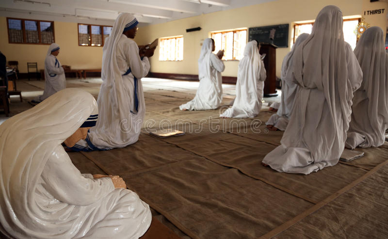 Sisters of Missionaries of Charity in prayer in the chapel of the Mother House, Kolkata. Sisters of Mother Teresa`s Missionaries of Charity in prayer in the royalty free stock images