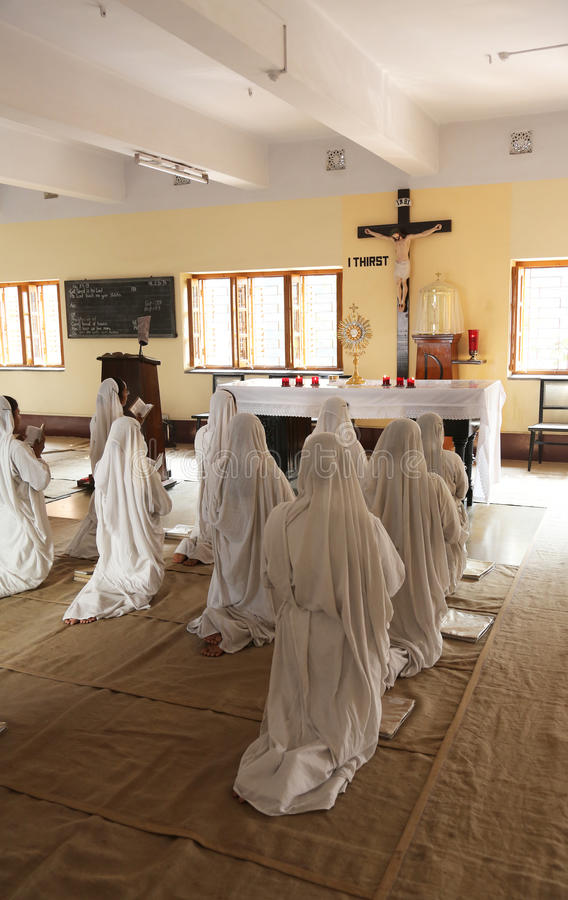 Sisters of Missionaries of Charity in prayer in the chapel of the Mother House, Kolkata. Sisters of Mother Teresa`s Missionaries of Charity in prayer in the stock images