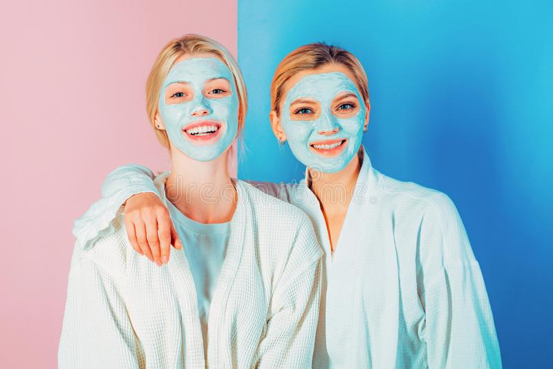 Sisters or mom and daughter chilling making clay facial mask. Anti age mask. Stay beautiful. Skin care for all ages royalty free stock images