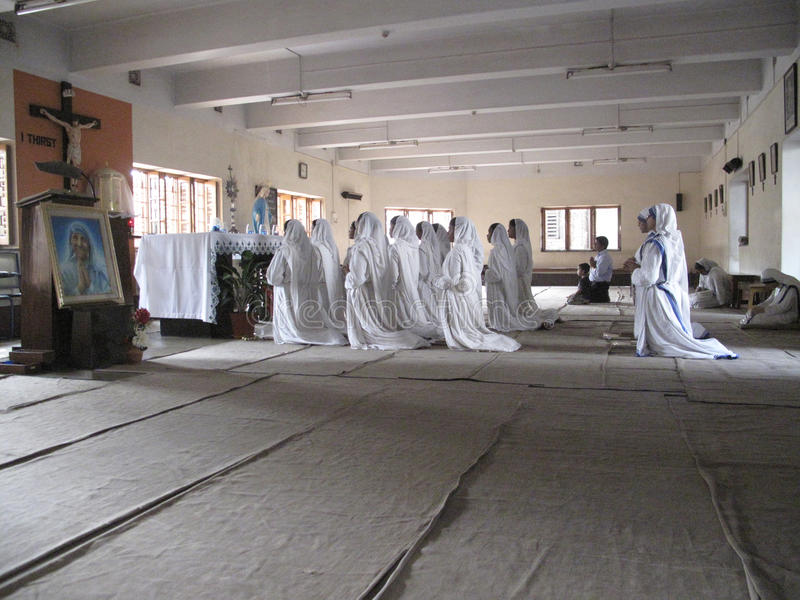 Sisters of Mother Teresa's Missionaries of Charity in prayer. In the chapel of the Mother House, Kolkata, India at January 27, 2009 royalty free stock images