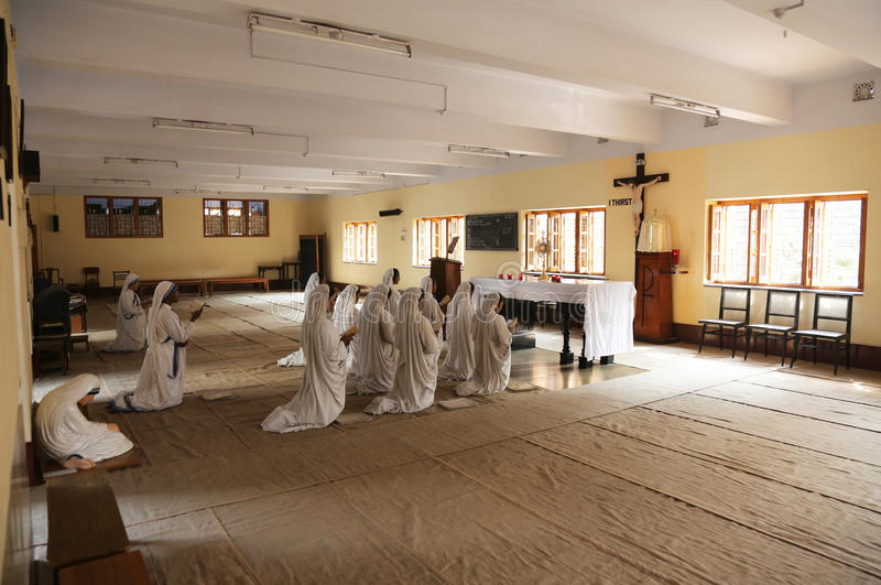 Sisters of Mother Teresa`s Missionaries of Charity in prayer in the chapel of the Mother House, Kolkata. India at February 08, 2014 royalty free stock photos