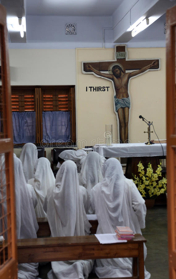 Sisters of Mother Teresa`s Missionaries of Charity in prayer in the chapel of the Mother House, Kolkata. India at February 07, 2014 stock photo