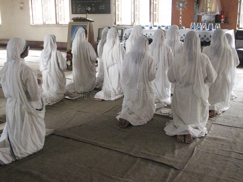 Sisters of Mother Teresa's Missionaries of Charity in prayer, Kolkata. Sisters of Mother Teresa's Missionaries of Charity in prayer in the chapel of the Mother royalty free stock photography