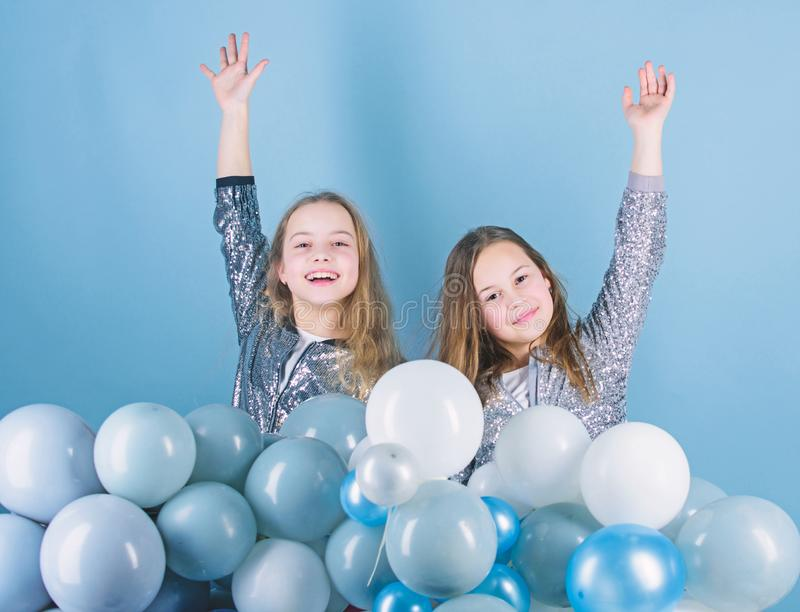 Sisters organize home party. Having fun concept. Balloon theme party. Girls little siblings near air balloons. Birthday. Party. Happiness and cheerful moments stock image