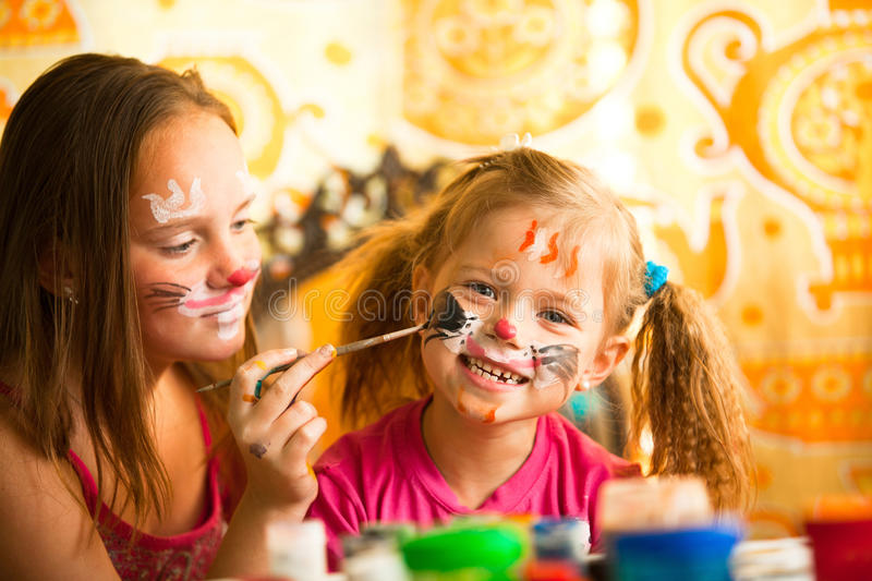 Download Sisters Playing With Painting Stock Photo - Image: 25611872