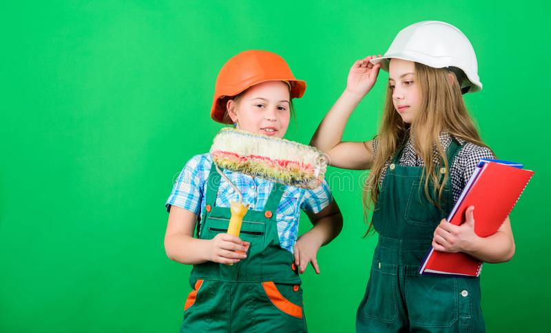 Sisters renovating home. Dreaming about new playroom. Home improvement activities. Future profession. Kids girls. Planning renovation. Children sisters run royalty free stock images