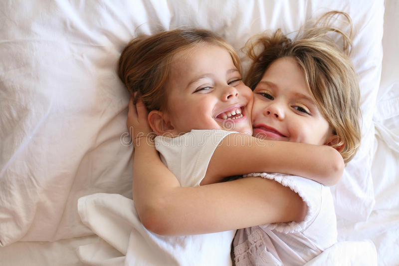 Sisters sharing moments of love. stock image