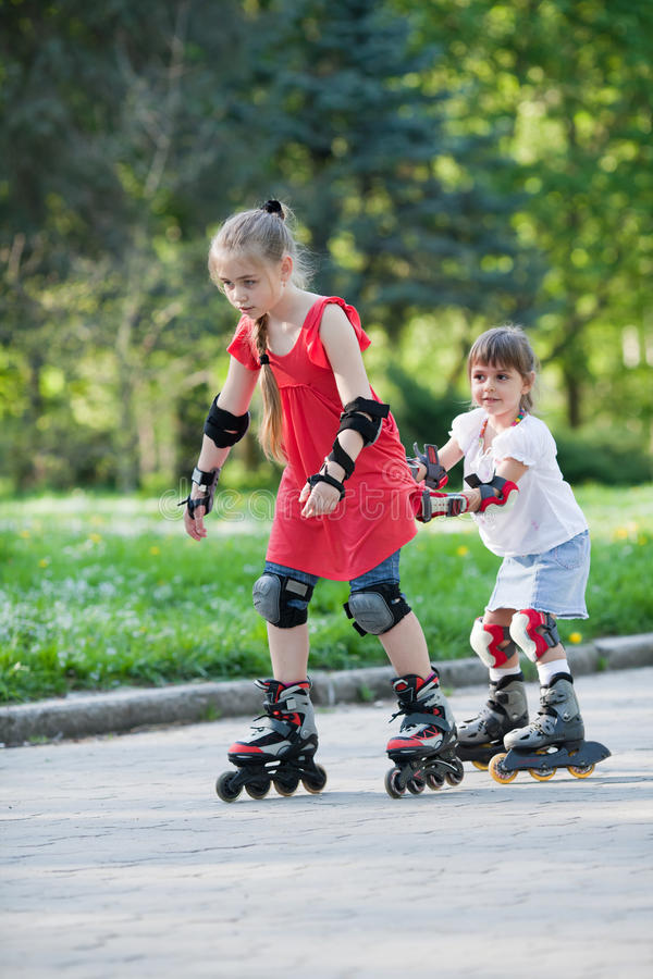 Download Sisters skating in park stock photo. Image of female - 25000040
