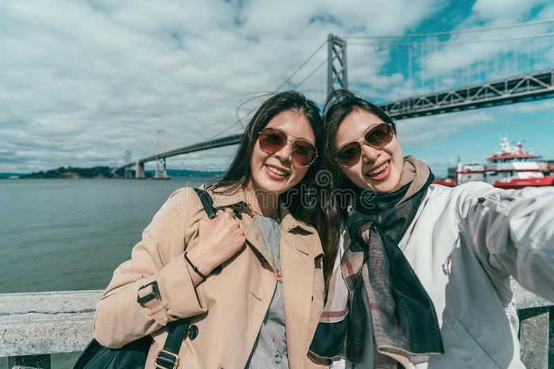 Sisters taking selfies with a sightseeing view royalty free stock photography