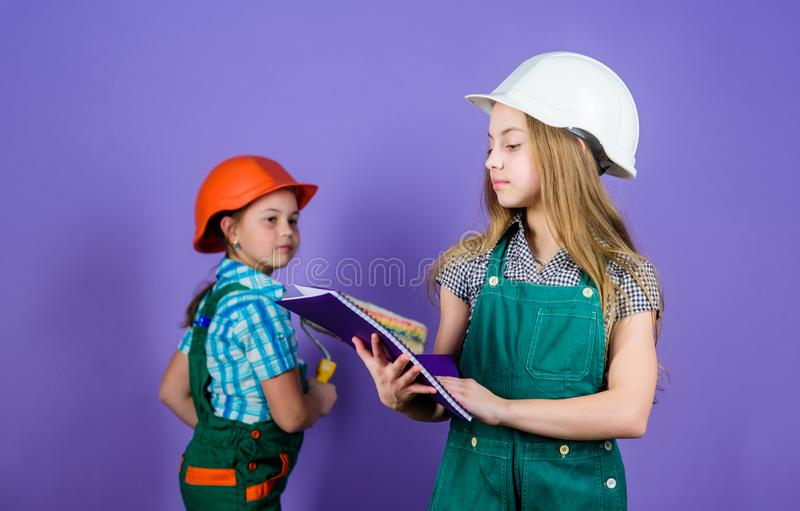 Sisters team renovating home. Home improvement activities. Kids girls planning renovation. Repaint walls. Move in new. Apartment. Children sisters run royalty free stock image