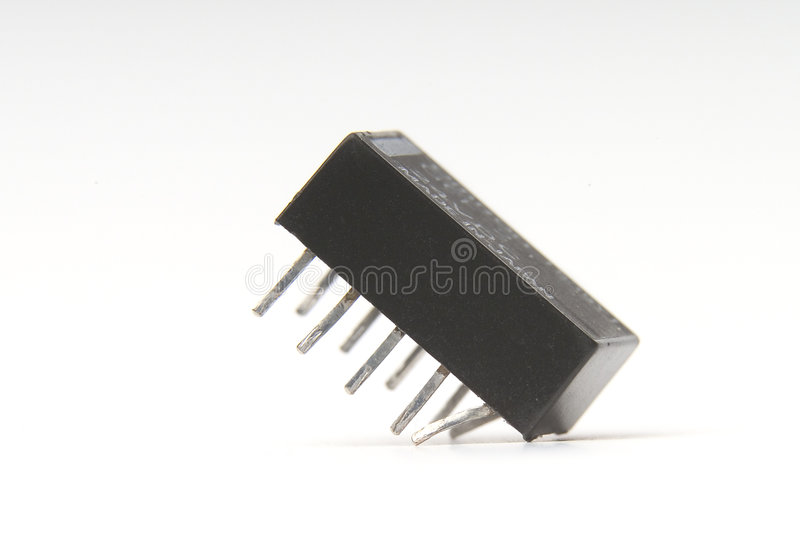 Sit nice. Electronic relay sitting with bent pins. This is not an IC but a relay. The component has marks of use with solder on pins and small scratches and dust stock images