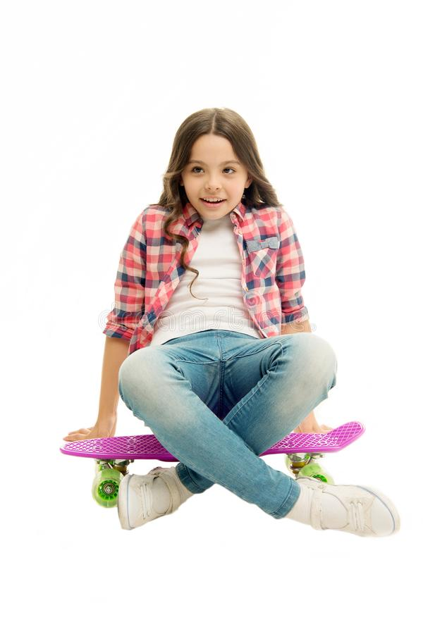 Sit and relax. Kid girl relaxed sits penny board. Learning how to ride penny board. Modern teen hobby. Girl happy face stock photography