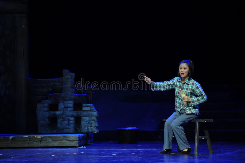 Sit on the stool and stitch insoles- Jiangxi opera a steelyard. Jiangxi opera a steelyard is adapted from a true story: the last century fortys, the protagonists royalty free stock images
